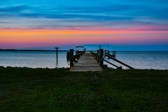 Into the Evening Sky. A scenic landscape of a dock on the Chesapeake Bay in Virginia with the colorful evening sky in the background royalty free stock photography