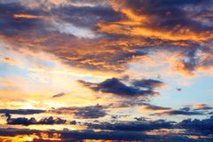 Evening sky. With the setting sun and dark colored clouds Stock Photo