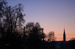 Evening sky with silhouettes of trees and mosque stock photography