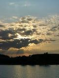 Evening skylight. Evening clouds and sunrays burst through its gap Stock Photos