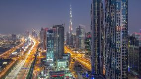 Evening skyline with modern skyscrapers and traffic on sheikh zayed road day to night timelapse in Dubai, UAE. Evening skyline with modern skyscrapers and stock video