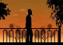 Evening smoker. Man in the hat at sunset on a background of southern nature and birds Stock Images