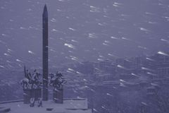 Evening snow storm monument Stock Photos
