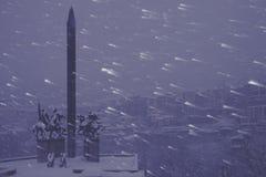 Evening snow storm monument Stock Photos
