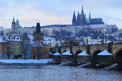 Evening snowy Prague gothic Castle with Charles Bridge, Czech Republic Royalty Free Stock Photos