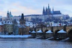 Evening snowy Prague gothic Castle with Charles Bridge, Czech Republic Royalty Free Stock Photos