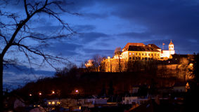 Evening Spilberk Castle in Brno with a tree. Late evening panorama view of Spilberk Castle in Brno with a tree branch in one corner and dark clouds in another royalty free stock photos