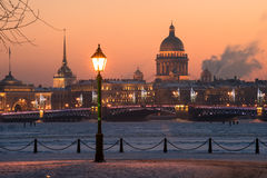 Evening St. Petersburg. View of the evening city decorated with lights. In the foreground a street light. In the background, the main attractions - the Palace Stock Photo