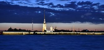 Evening St. Petersburg, view of the Peter and Paul fortress. Night walk in St. Petersburg on the promenade overlooking the Peter and Paul Fortress Royalty Free Stock Photography