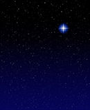 Evening Star. A shining star against a star field background with blue tones stock photography