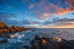 Evening on the stone seashore. Royalty Free Stock Photography