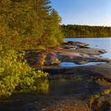 Evening at stony shore of Ladoga lake Royalty Free Stock Photos