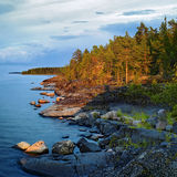 Evening at stony shore of Ladoga lake Stock Photography