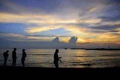 Evening  stories at beach. Sunset over the sea is the best scene to enjoy during evening time.Especially after having a hectic day at works, it will give a Stock Photography