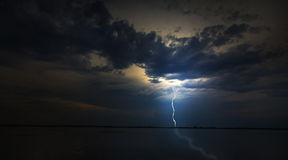 Evening storm over lake in remote wild area Royalty Free Stock Photo