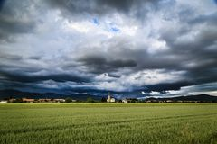 Evening storm over the medieval village Royalty Free Stock Images