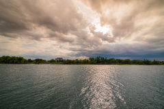 Evening storm over river and dramatic sky and clouds Royalty Free Stock Photography