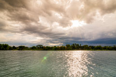 Evening storm over river and dramatic sky and clouds Royalty Free Stock Images