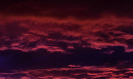 Evening. The storm sky with various shades of red and violet color, with dark clouds Stock Photos