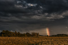 Evening Stormy Cloudy Blue Gray Sky. Use it As a Background. Rainbow in Background. Stock Images