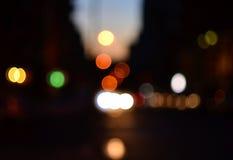 Evening street defocused cars lights background Royalty Free Stock Image