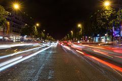 Evening streetview with illumination and traffic of Paris Champs Elysees Royalty Free Stock Images