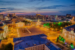 Evening summer cityscape from rooftop. Lenin Square, Voronezh downtown Stock Photos