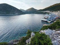 Evening summer coastline with cargo ship  (Ston, Croatia) Stock Photo