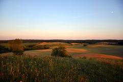 Evening summer landscape in Brandenburg, Germany. Evening summer landscape with moon in Brandenburg, Germany Stock Photo