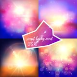 Evening sun backgrounds set. Dark blue, purple and golden color mixes. Natural looking lens flare effect, realistic suns and play of light Stock Images
