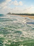 High Tide and Turquoise Green Water at Juno Beach. Evening sun casts shadows and light on the turquoise green water at Juno Beach in Florida stock photo