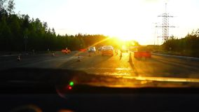 Evening sun on forest road and cars stock video