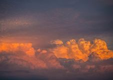 By the evening sun illuminated cumulonimbus over the city of Erl Stock Images