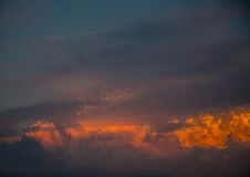 By the evening sun illuminated cumulonimbus over the city of Erl Royalty Free Stock Photos