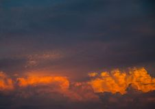 By the evening sun illuminated cumulonimbus over the city of Erl Royalty Free Stock Images