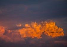 By the evening sun illuminated cumulonimbus over the city of Erl Stock Photo