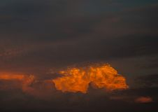 By the evening sun illuminated cumulonimbus over the city of Erl Stock Photography