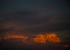 By the evening sun illuminated cumulonimbus over the city of Erl Royalty Free Stock Photo