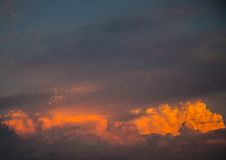 By the evening sun illuminated cumulonimbus over the city of Erl Royalty Free Stock Image
