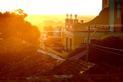 Evening sun. The last evening sun peaking over a roof in Trinidad Cuba royalty free stock image