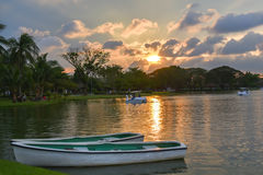 Evening Sun Light And Row Boat in Lake Park Thailand.  Stock Photo