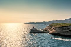 Evening sun on lighthouse at entrance to Bonifacio port stock photos