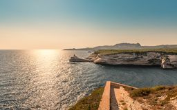 Evening sun on lighthouse at entrance to Bonifacio port royalty free stock photos