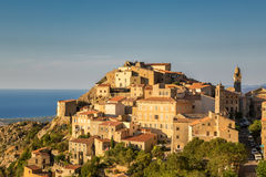 Evening sun on mountain village of Speloncato in Corsica Stock Images