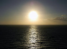 The evening sun over the ocean... Stock Photo