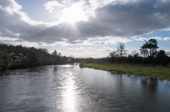 Evening sun over the river Wye in the countryside of the United kingdom. A view the River Wye in Herefordshire in the British countryside Stock Photo