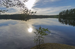 The evening sun is reflected in a small lake Royalty Free Stock Image