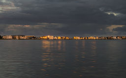 Evening sun reflects off millionaire's mansions across Poole Harbour Royalty Free Stock Photos