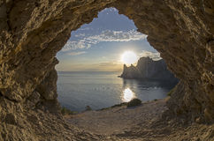 Evening sun setting behind the coastal cliffs. Crimea. Royalty Free Stock Photo