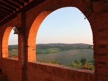 Evening sun in the Siena countryside. View of the evening Siena countryside from the arched brick terrace Royalty Free Stock Image